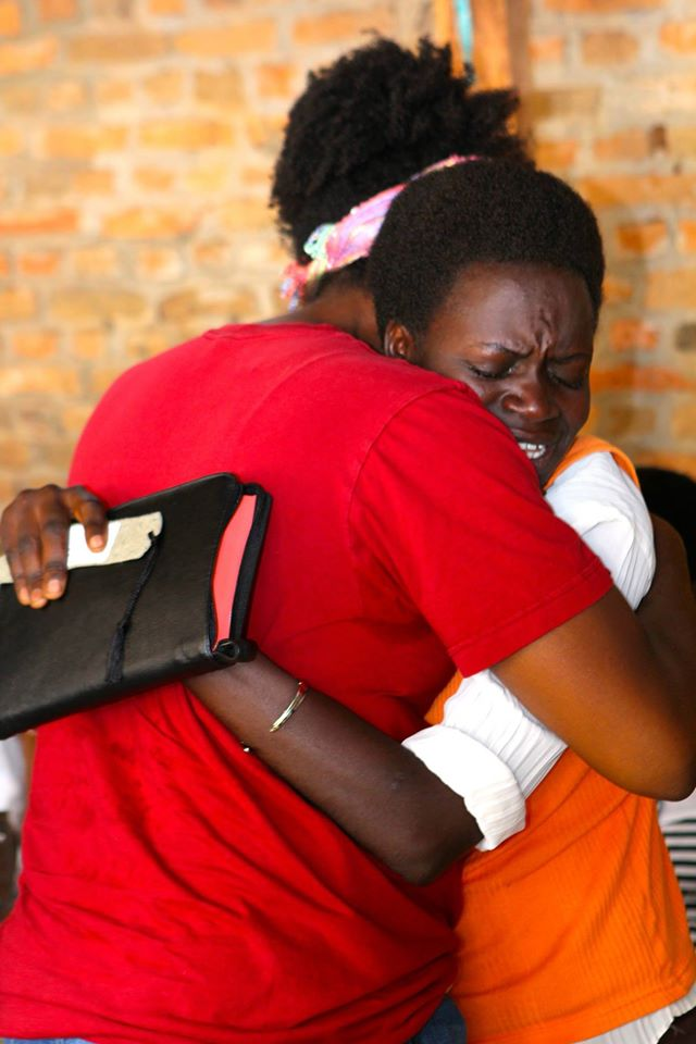hugging lady after receiving bible